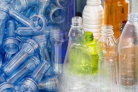 The abstract scene of the preform shape and the various type of plastic drinking water bottle products. The various type of PET bottles container products manufacturing concept . Stock Photo