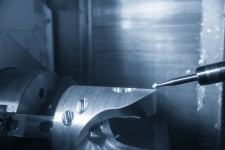 The 5-axis CNC milling machine cutting the automotive parts with solid ball end mill tools.The hi technology automotive part manufacturing process by 5 axis multi tasking machining centre with endmill