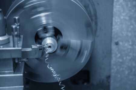 Close-up scene of the lathe machine operation while  cutting the metal parts with the cutting tools. The metal working processing by turning machine . Stock Photo