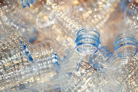 Close up scene pile of PET bottles products on the container box. The drinking water bottles manufacturing process concept. Stock Photo
