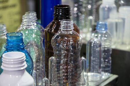 The various type of plastic bottles. The drinking water bottles production concept.
