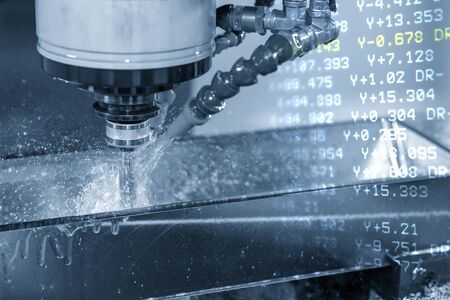 The abstract scene of the G-code data and the CNC milling machine cutting the forging mold parts with solid ball endmill tools. Hi-precision mould and die production process by machining center.