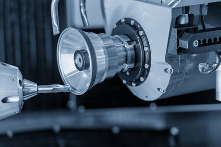 The operation of cutting tool making machine control by CNC program. The solid ball endmill of CNC cutting tool grinding process.