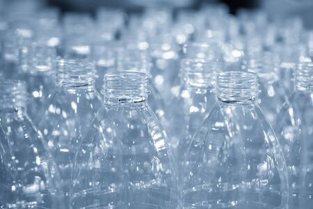 The stock of the PET bottles in the warehouse  waiting for drinking water manufacturing process. The plastic bottles after blowing process keep in wear house.