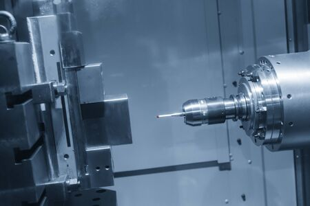The Coordinate Measuring machine ,CMM probe attach on the horizontal milling machine measure dimension of the sample parts .The quality control in manufacturing process by multi-axis CMM machine. Stock Photo