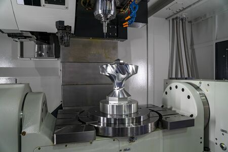 The 5-axis CNC milling machine  cutting the sample of aluminium  parts by solid ball endmill tools. The automotive parts manufacturing process by 5-axis machining center.