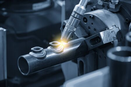 The abstract scene of robotic arm welding machine . The hi technology automotive parts manufacturing process by robotic system for  electric welding machine. Reklamní fotografie