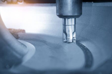 The CNC milling machine rough cutting the casting mold parts by indexable  radius endmill tools. The mold and die manufacturing process by machining center with the solid endmill tools.