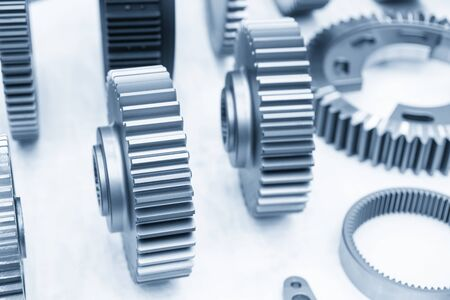 The close-up scene of transmission gear parts separation in the light blue scene. The mechanical parts manufacturing process concept for automotive industrial . Standard-Bild
