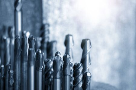 The group of used endmill tools in the light blue scene.The various type of cutting tool for CNC milling machine.
