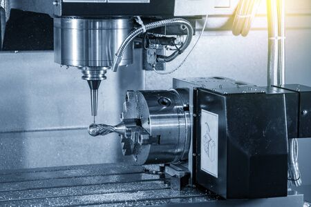 The 4 axis CNC milling machine cutting the sample parts attach on the rotary table with solid ball endmill tools. The hi-technology metalworking manufacturing process by 4 axis machining center. Banque d'images