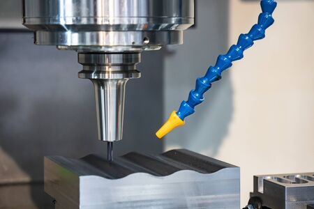 The CNC milling machine finishing cut the sample parts by  solid ball  endmill tools. The mold and die manufacturing process by machining center with the solid carbide endmill tools. 写真素材