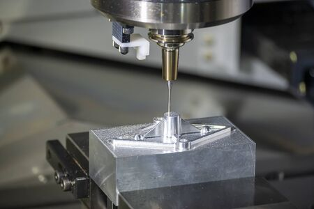 The CNC milling machine finishing cutting  the injection mold parts by  solid ball  endmill tools. The mold and die manufacturing process by machining center with the solid carbide endmill tools. Stock Photo