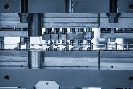 The progressive die operation by making the sheet metal parts for automotive industry. The hi-precision parts manufacturing process by press die processing.