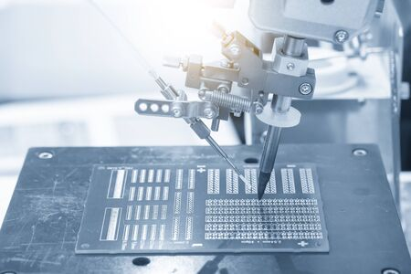 The operation of wiring the motherboard by robotic soldering machine. The industry 4.0 in electronics parts manufacturing process by automatic system.