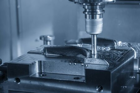The CNC milling machine rough cutting the injection mold parts by indexable endmill tools. The mold and die manufacturing process by machining center with the solid endmill tools.