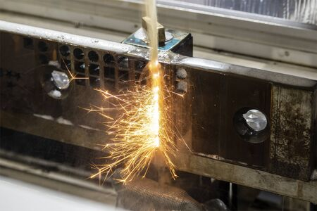 The sparking light from wire-EDM machine. The operation of wire-cut machine. Stock fotó