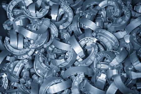 The pile of aluminium casting parts of drum brake. The automotive parts manufacturing process by die casting process.