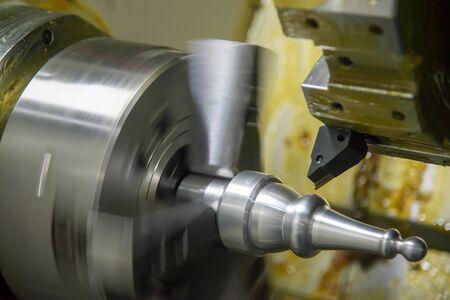 The  CNC lathe machine finish cut the metal shaft parts. The hi-technology metal working processing by CNC turning machine . Zdjęcie Seryjne