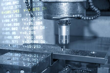 The abstract scene of CNC milling machine and the G-code data background. The mold and die manufacturing process by machining center . Zdjęcie Seryjne