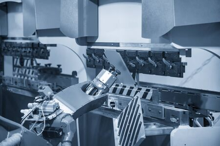 The robotic arm operation at hydraulic bending machine. The hi technology sheet metal forming process by robotic system. Zdjęcie Seryjne