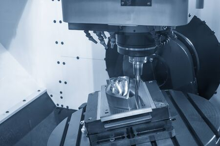 The 5 axis CNC machining center cutting the automotive mold parts with solid barrel end mill tools. The hi-technology automotive part manufacturing process by 5 axis CNC milling machine.