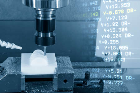The abstract scene of CNC milling machine and the G-code data background. The POM plastic cutting process with  machining center .