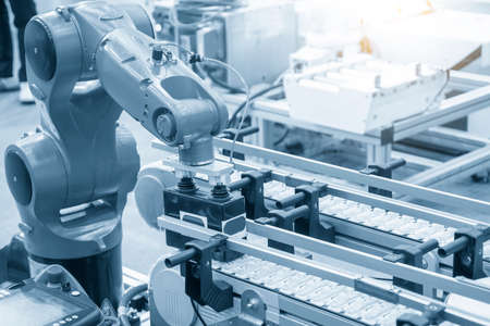 The material handling process by automatic robotic system. The hi-autonomous technology  production line by robotic arms.