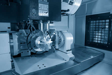 The 5 axis CNC machining center cutting the mechanical parts with solid ball end-mill tools. The hi-technology mechanical part manufacturing process by 5 axis CNC milling machine.