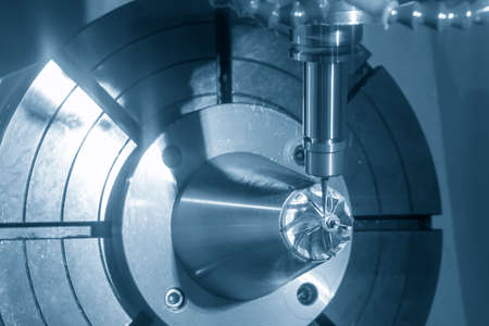The  5 axis CNC milling machine cutting the turbine blade parts with solid ball end-mill tools. The hi-technology automotive part manufacturing process by 5 axis machining center.