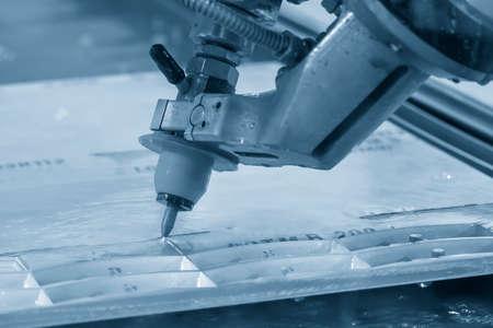 Abrasive multi-axis water-jet machine cutting the aluminium plate. Hi-technology metal cutting by water jet  cutting machine . Standard-Bild