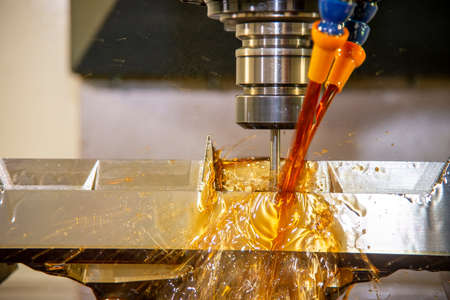 The CNC milling machine cutting the  mold parts by solid end mill tools. The mold and die manufacturing process by CNC machining center.