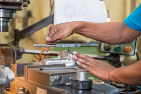 The tapping operation by skill worker. The thread making by hand tapping tool with