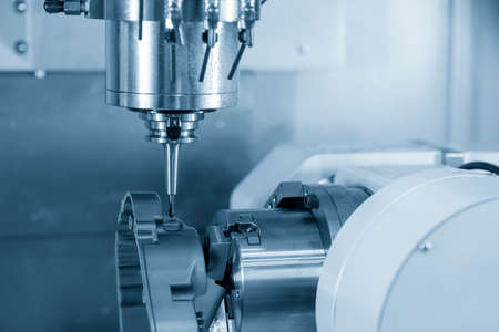 4-axis CNC machining center cutting the automotive parts. Hi-technology manufacturing by multi-axis CNC milling machine.