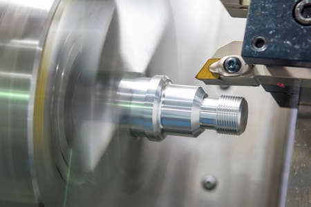 The CNC lathe machine thread cutting the metal shaft part. The hi-accuracy part manufacturing process by turning machine.