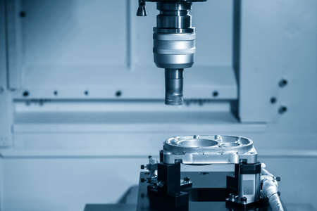 The CNC milling machine rough cutting  the aluminum casting  parts by indexable  endmill tools. The automotive parts manufacturing process by machining center. 版權商用圖片 - 159408356