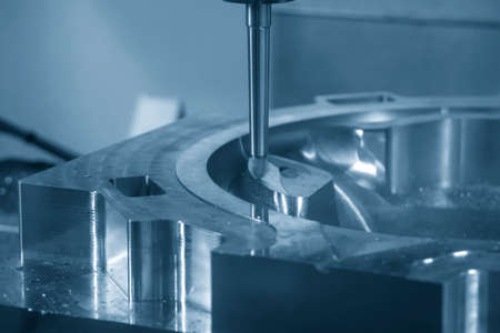 The CNC milling machine cutting the die casting mold part with solid ball endmill tool. The hi-technology mold and die manufacturing  process by machining center. 版權商用圖片 - 160042816
