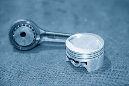 The part of piston and cylinder head of motorcycle engine. The motorbike parts repairing process.
