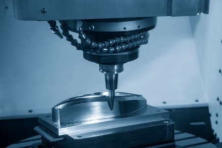 The 5 axis CNC machining center cutting the automotive mold parts with solid barrel end mill tools. The hi-technology automotive part manufacturing process by 5 axis CNC milling machine. 版權商用圖片 - 161048198
