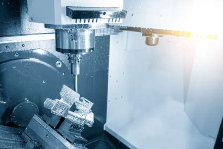 The 5-axis machining center cutting the aerospace part with solid ball endmill tool. The hi-precision manufacturing process by multi-axis CNC milling machine.
