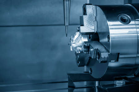 The 4-axis machining center cutting the turbocharger blade with solid ball end mill tool. The automotive part manufacturing process by multi-axis machining center. Banco de Imagens