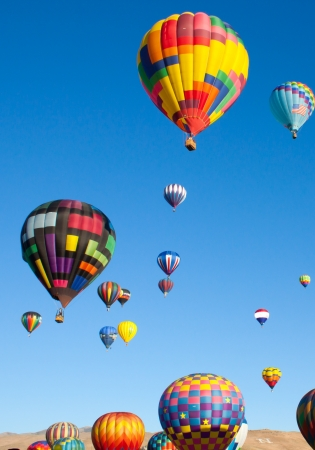 aloft: Colorful Hot Air Balloons on a Sunrise Flight Stock Photo