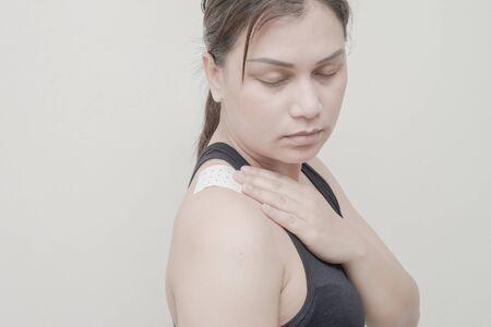 working stiff: Women Neck, shoulder pain and sticking plaster.