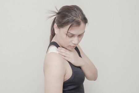 cramped: Women Neck, shoulder pain and sticking plaster.