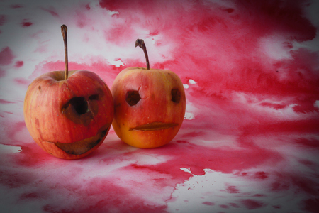 Background Scary Halloween ghost made of apple. Stock Photo