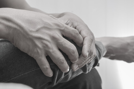 contracture: Man knee and leg pain black and white picture.Conception of illness