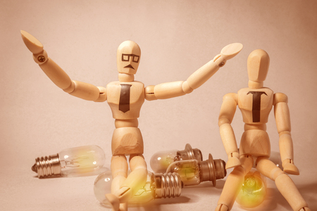Wooden puppets and light bulbs Creative concept