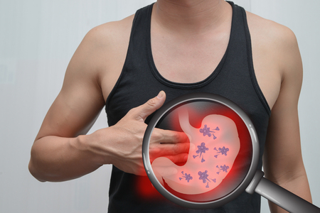 Man Stomach Pain And stomach image.The concept is easy to understand information about the disease.