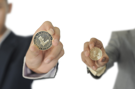LTC cion (Litecoin) in the hands of the two businessman.   Isolate on a white background.