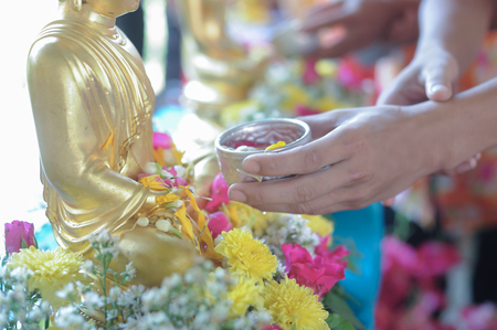 Watering Buddha at the Water Festival Stock Photo